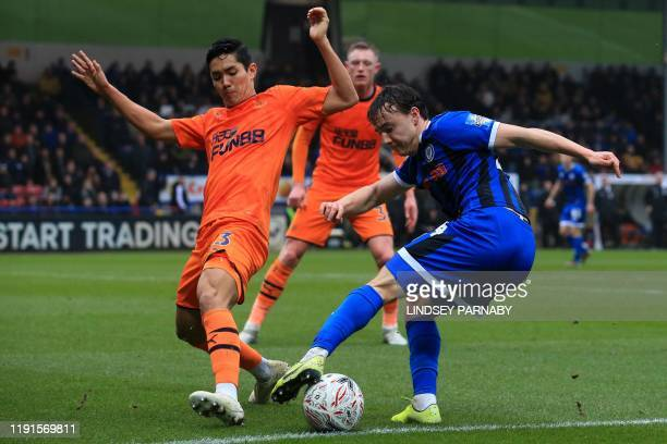 Newcastle United's Japanese striker Yoshinori Muto vies with Rochdale's English midfielder Oliver Rathbone during the English FA Cup third round...