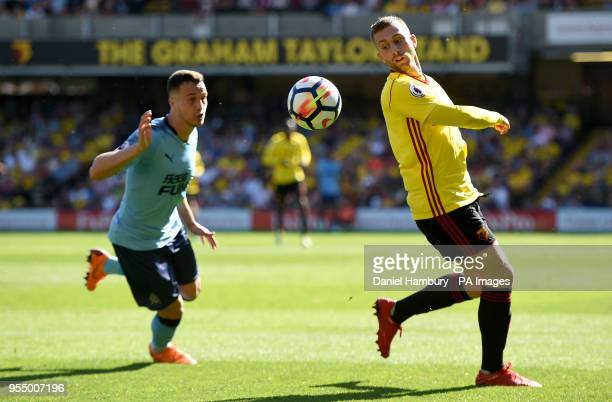 Newcastle United's Javier Manquillo and Watford's Gerard Deulofeu battle for the ball during the Premier League match at Vicarage Road Watford