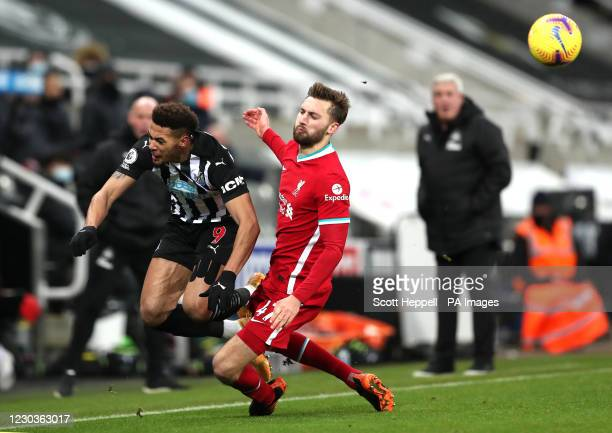 Newcastle United's Joelinton collides with Liverpool's Nathaniel Phillips during the Premier League match at St James' Park, Newcastle.