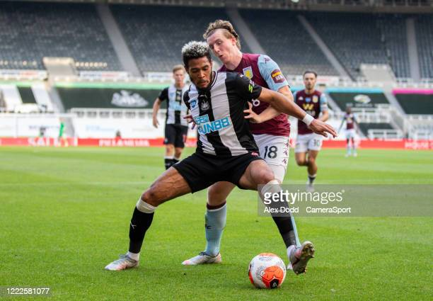Newcastle United's Joelinton shields the ball from Aston Villa's Matt Targett during the Premier League match between Newcastle United and Aston...