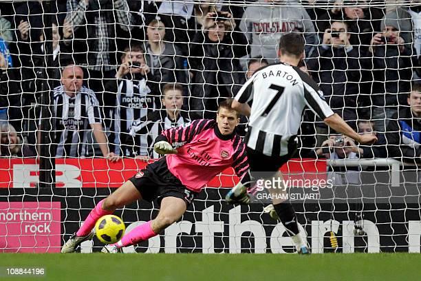 Newcastle United's Joey Barton scores a penalty past Arsenal's Polish goalkeeper Wojciech Szczesny during the English Premier League football match...