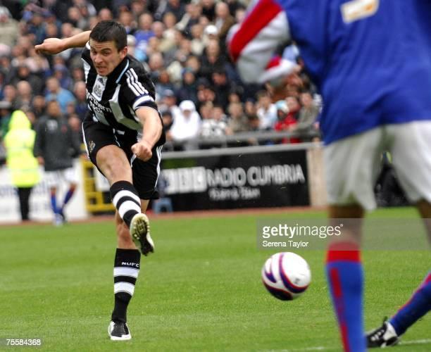 Newcastle United's Joey Barton Strikes the ball during a pre-season friendly between Carlisle United and Newcastle United at Brunton Park in Carlisle...