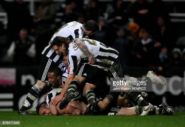Newcastle United's Jose Enrique is congratulate by his teammates after scoring their secon goal of the game