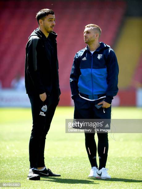 Newcastle United's Joselu and Watford's Gerard Deulofeu talk on the pitch before the Premier League match at Vicarage Road Watford