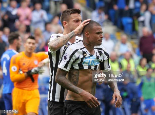 Newcastle United's Joselu consoles team mate Kenedy and the final whistle during the Premier League match between Cardiff City and Newcastle United...