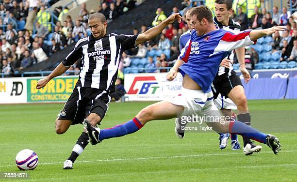 Newcastle United's Keiron Dyer is challenged by Carlisles Danny Livesey during a pre-season friendly between Carlisle United and Newcastle United at...