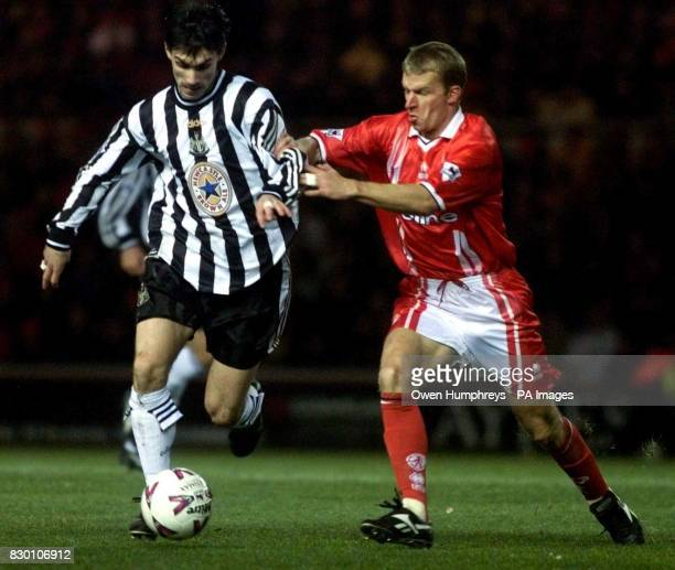 Newcastle United's Keith Gillespie and Middlesbrough's Robbie Mustoe fight for the ball during today's December 6 Premiership clash at Riverside...