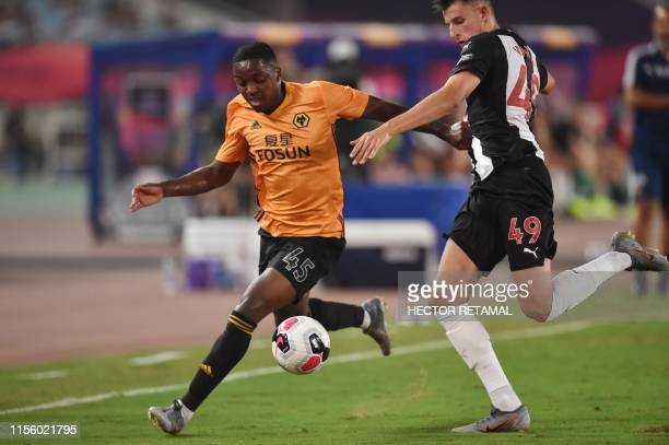 Newcastle United's Kelland Watts fights for the ball with Wolverhampton Wanderers's Niall Ennis during the 2019 Premier League Asia Trophy football...