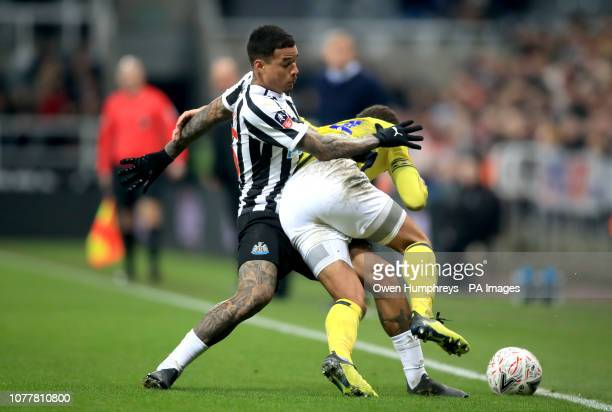 Newcastle United's Kenedy and Blackburn Rovers' Elliott Bennett battle for the ball during the Emirates FA Cup third round match at St James' Park...