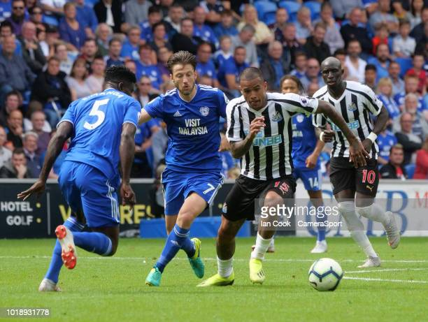 Newcastle United's Kenedy gets away from Cardiff City's Harry Arter during the Premier League match between Cardiff City and Newcastle United at...