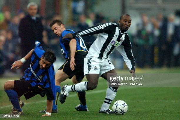 Newcastle United's Lomana LuaLua holds off Inter Milan's Francesco Coco
