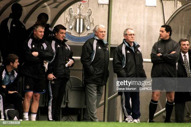 Newcastle United's manager Bobby Robson stands infront of the crest he defended earlier in the week at a press conference
