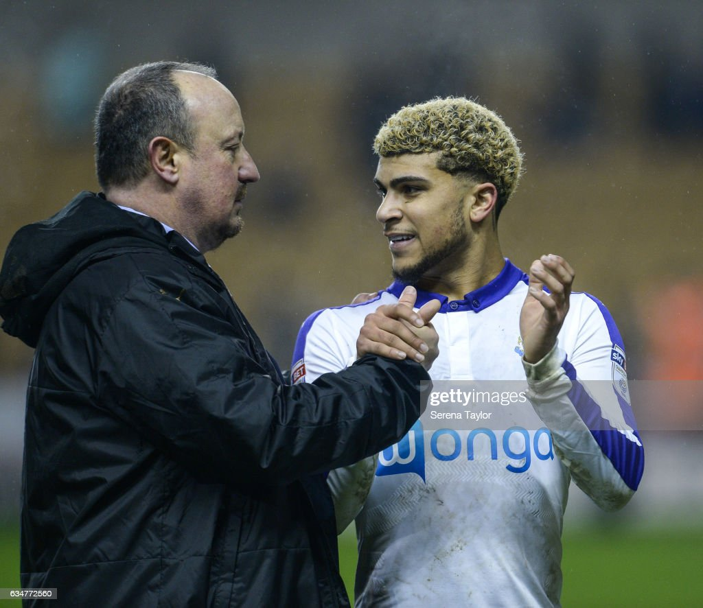 Newcastle United's Manager Rafael Benitez shakes hands with DeAndre Yedlin (R) during the Sky Bet Championship mpatch between Wolverhampton Wanderers and Newcastle United at Molineux on February 11, 2017 in North Shields, England.