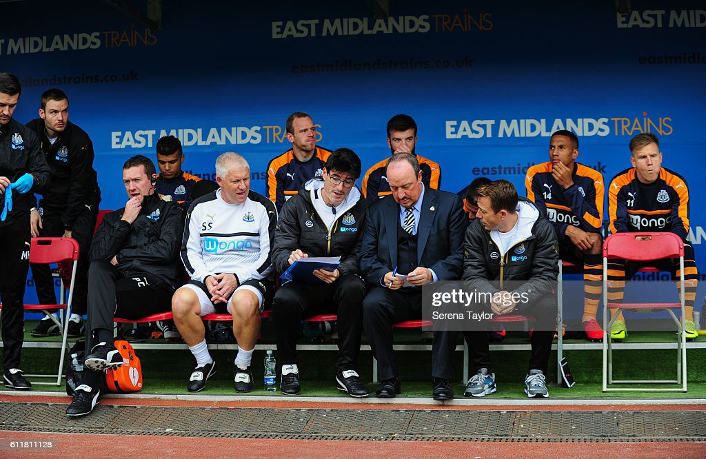 Newcastle United's Manager Rafael Benitez (front row and second from left) sits in dugouts during the Sky Bet Championship match between Rotherham United and Newcastle United at The New York Stadium on October 1, 2016 in Rotherham, England.