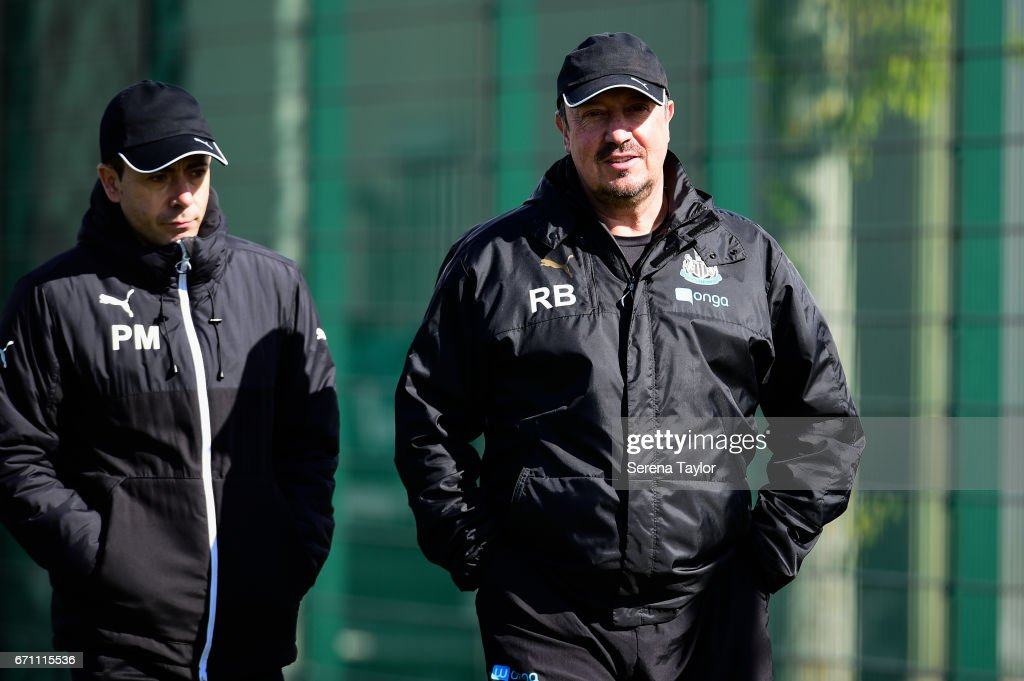 Newcastle United's Manager Rafael Benitez (R) smiles whilst walking outside with Newcastle United's Assistant Manager Francisco De Miguel Moreno (L) during the Newcastle United Training Session at the Newcastle United Training Ground on April 21, 2017 in Newcastle upon Tyne, England.