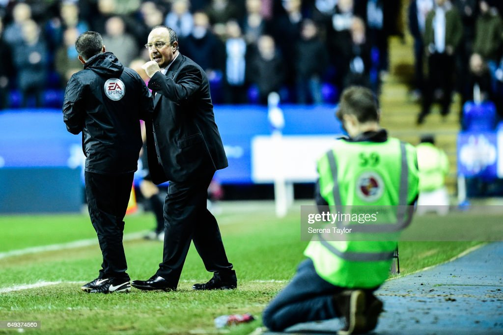 Newcastle Unitedâs Manager Rafael Benitez speaks to Fourth Official Keith Stroud during the Sky Bet Championship Match between Reading and Newcastle United at the Madjeski Stadium on March 7, 2017 in Reading, England.