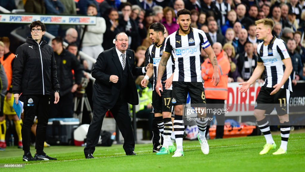 Newcastle United's Manager Rafael Benitez speaks with Ayoze Perez after Matt Ritchie penalty (not seen) is disallowed during the Sky Bet Championship Match between Newcastle United and Burton Albion at St.James' Park on April 5, 2017 in Newcastle upon Tyne, England.