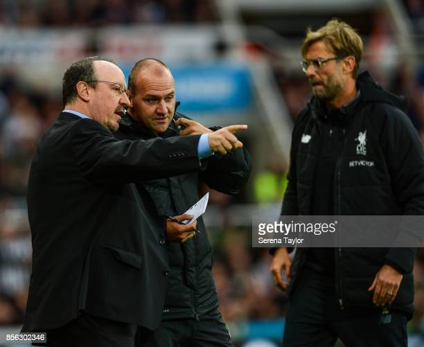 Newcastle United's Manager Rafael Benitez speaks with Fourth Official Bobby Madley during the Premier League Match between Newcastle United and...