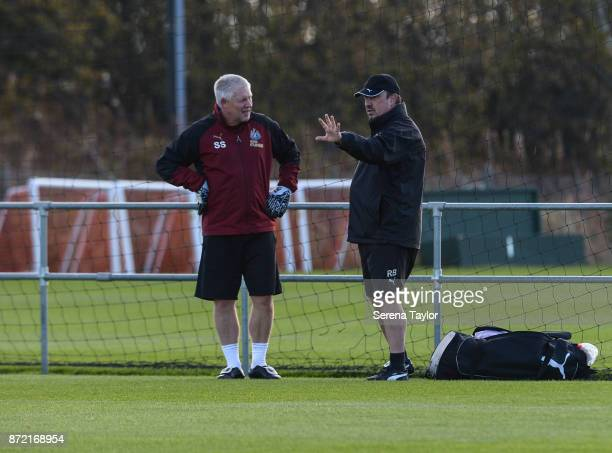 Newcastle United's Manager Rafael Benitez speaks with Goalkeeping coach Simon Smith during the Newcastle United Training session at the Newcastle...
