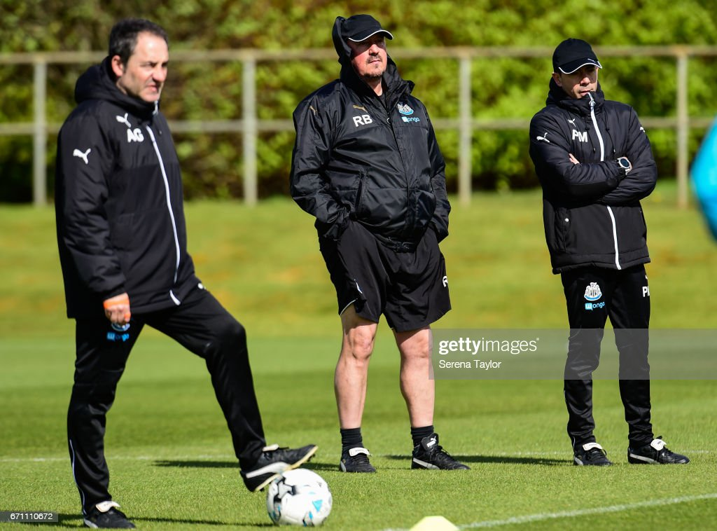 Newcastle United's Manager Rafael Benitez (C) stands watching training with Newcastle United's Head of Analysis and First Team Coach Antonio Gomez Perez (L) and Newcastle United's Assistant Manager Francisco De Miguel Moreno (R) during the Newcastle United Training Session at the Newcastle United Training Ground on April 21, 2017 in Newcastle upon Tyne, England.