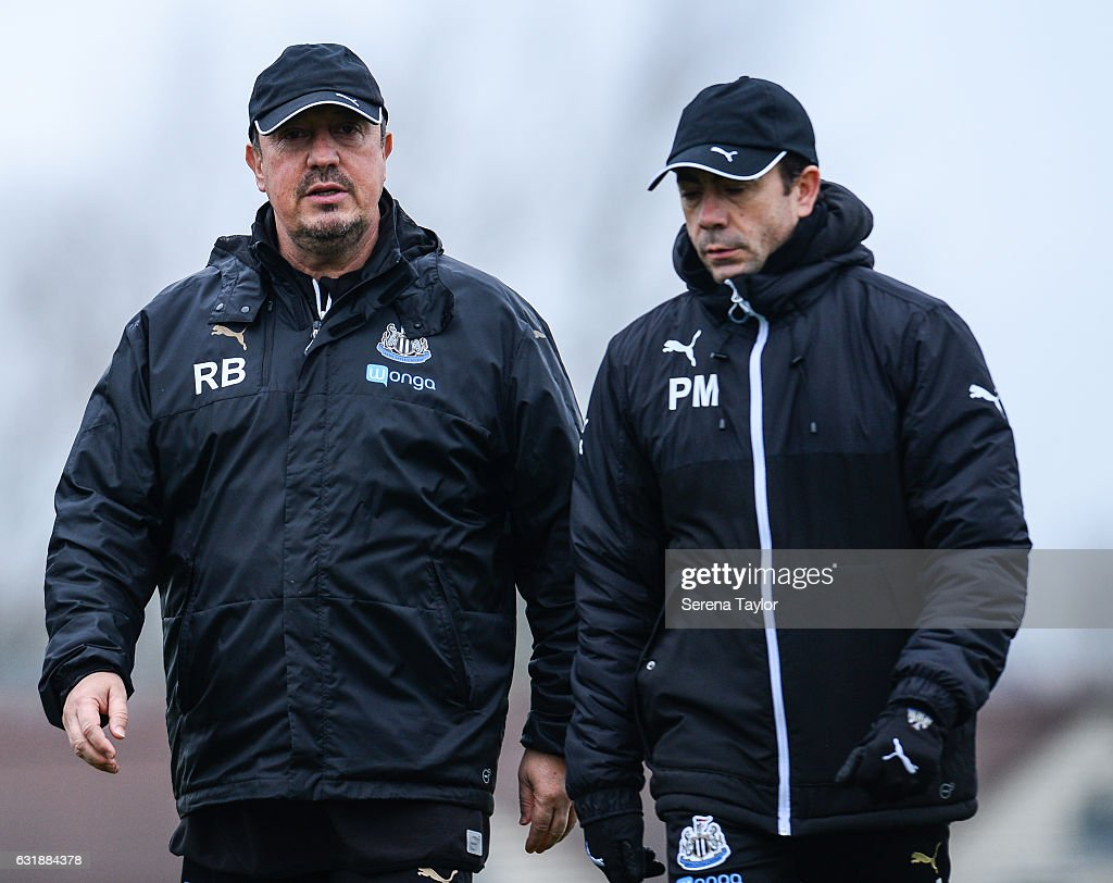 Newcastle United's Manager Rafael Benitez (L) walks out on the training pitch with Newcastle United's Assistant Manager Francisco De Miguel Moreno (R) during the Newcastle United Training Session at The Newcastle United Training Centre on January 17, 2017 in Newcastle upon Tyne, England.
