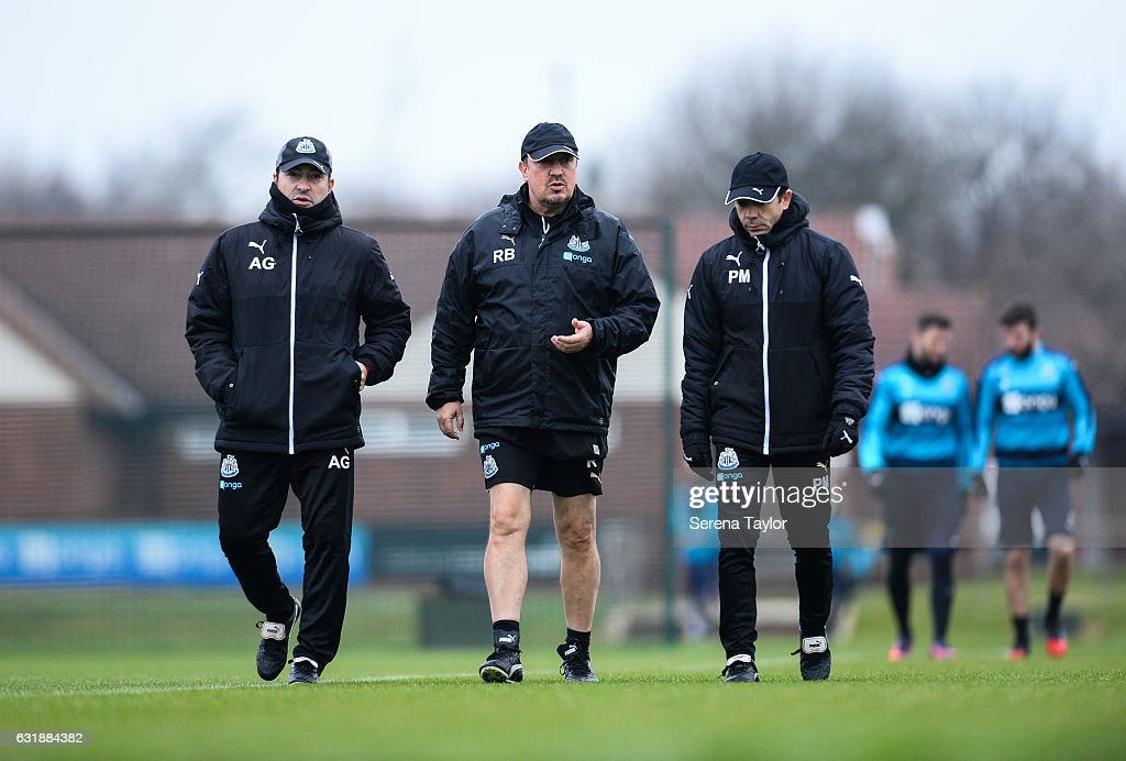 Newcastle United's Manager Rafael Benitez (C) walks out on the training pitch with Newcastle United's Head of Analysis and First Team Coach Antonio Gomez Perez (L) and Newcastle United's Assistant Manager Francisco De Miguel Moreno (R) during the Newcastle United Training Session at The Newcastle United Training Centre on January 17, 2017 in Newcastle upon Tyne, England.
