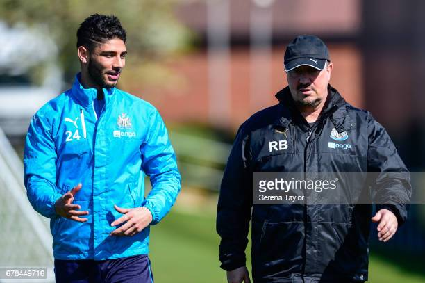 Newcastle United's Manager Rafael Benitez walks outside with Achraf Lazaar during the Newcastle United Training Session at The Newcastle United...
