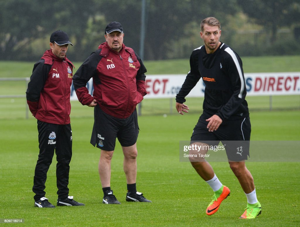 Newcastle UnitedÕs Manager Rafael Benitez (R) watches from the sidelines with Newcastle UnitedÕs Assistant Manager Francisco De Miguel Moreno as New signing Florian Lejeune runs on the pitch during the Newcastle United Training session at the Newcastle United Training Centre on July 5, 2017, in Newcastle upon Tyne, England.