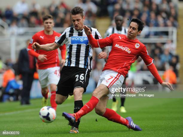 Newcastle United's Mathieu Debuchy is tackled by Cardiff City's Peter Whittingham during the Barclays Premier League match at St James' Park Newcastle