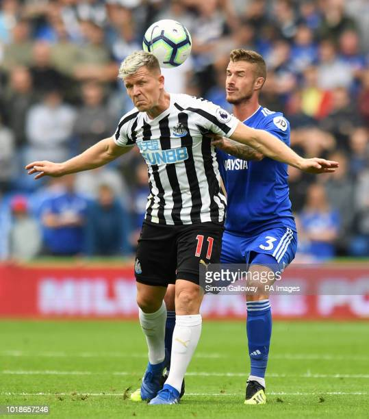 Newcastle United's Matt Ritchie and Cardiff City's Joe Bennett battle for the ball during the Premier League match at the Cardiff City Stadium