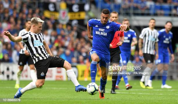 Newcastle United's Matt Ritchie and Cardiff City's Victor Camarasa battle for the ball during the Premier League match at the Cardiff City Stadium