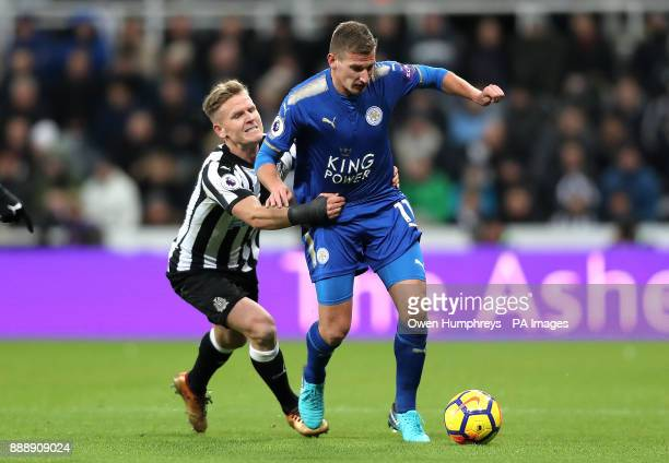 Newcastle United's Matt Ritchie and Leicester City's Marc Albrighton battle for the ball during the Premier League match at St James' Park Newcastle