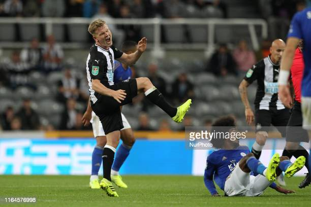 Newcastle United's Matt Ritchie reels away in pain after a tackle from Leicester City's Hamza Choudhury during the Carabao Cup match between...
