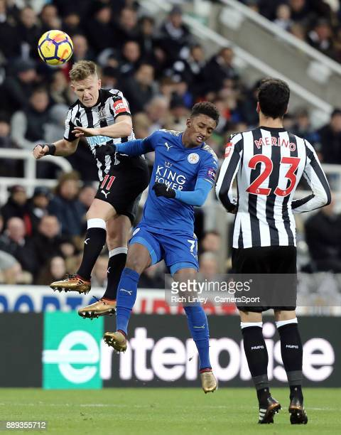 Newcastle United's Matt Ritchie wins a header despite the attentions of Leicester City's Demarai Gray during the Premier League match between...