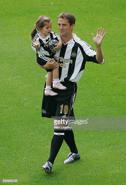 Newcastle United's new signing Michael Owen holds his daughter Gemma as he is introduced to the fans at St James' Park on August 31 2005 in Newcastle...