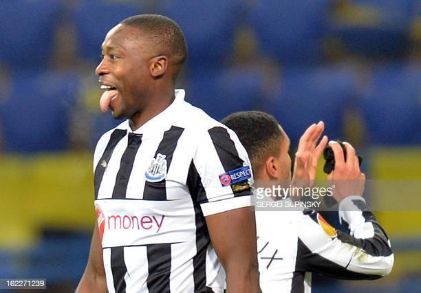 Newcastle United's Nigerian forward Shola Ameobi pokes out his tongue as he celebrates his goal against FC Metalist Kharkiv during their UEFA Europa...