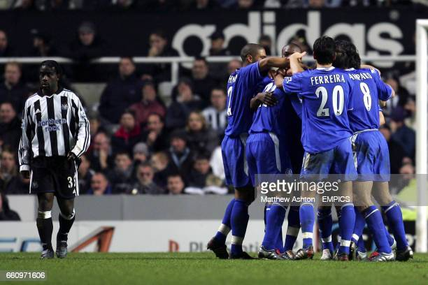 Newcastle United's Olivier Bernard stands dejectd as Chelsea players celebrate Eidur Gudjohnsen's goal in extra time's
