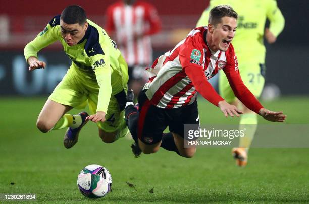 Newcastle United's Paraguayan midfielder Miguel Almiron and Brentford's Spanish striker Sergi Canos compete during the English League Cup quarter...