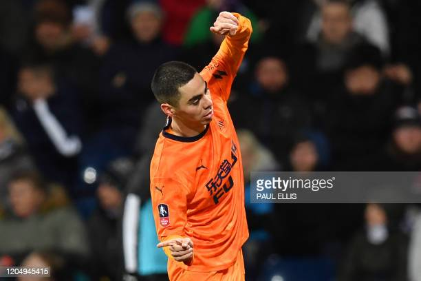 Newcastle United's Paraguayan midfielder Miguel Almiron celebrates after he scores his team's first goal during the English FA Cup fifth round...