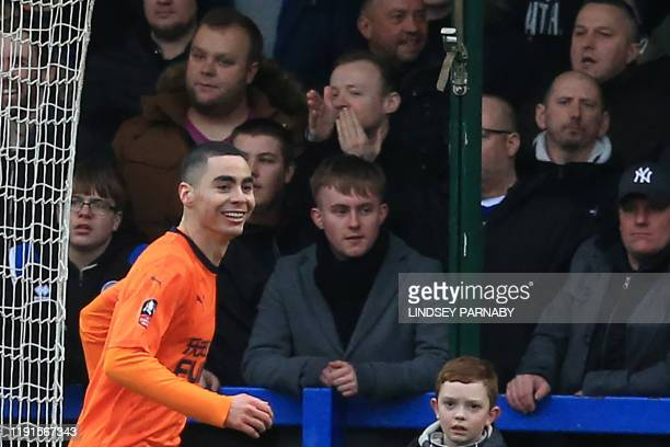 Newcastle United's Paraguayan midfielder Miguel Almiron celebrates scoring his team's first goal during the English FA Cup third round football match...