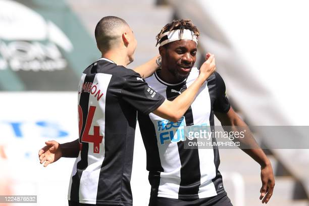 Newcastle United's Paraguayan midfielder Miguel Almiron celebrates with Newcastle United's French midfielder Allan Saint-Maximin after scoring a goal...