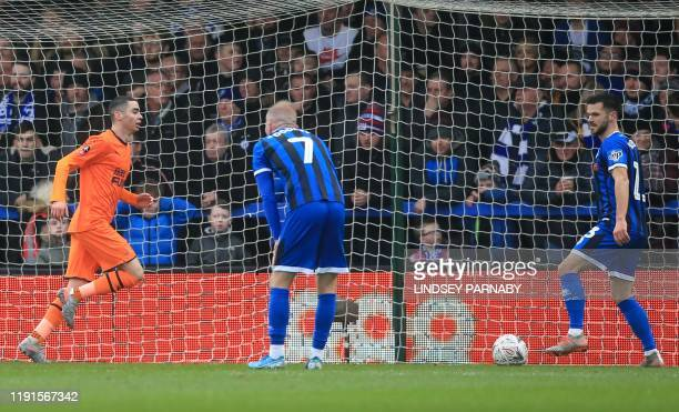 Newcastle United's Paraguayan midfielder Miguel Almiron reacts after scoring his team's first goal during the English FA Cup third round football...