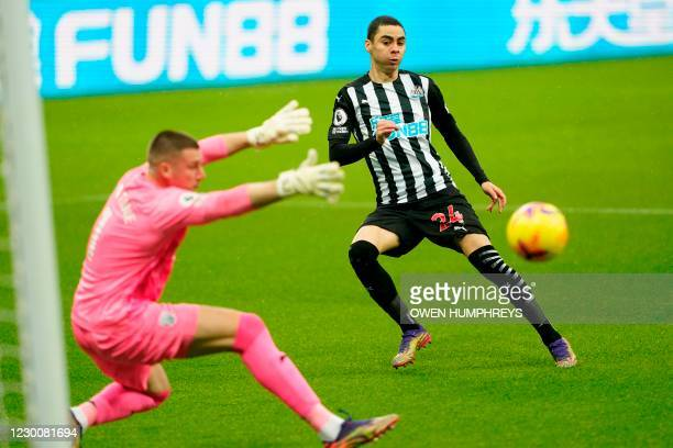 Newcastle United's Paraguayan midfielder Miguel Almiron shoots past West Bromwich Albion's English goalkeeper Sam Johnston to score in the first...