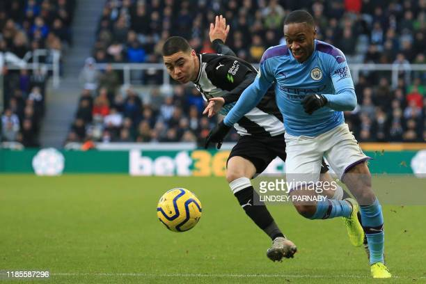 Newcastle United's Paraguayan midfielder Miguel Almiron vies with Manchester City's English midfielder Raheem Sterling during the English Premier...