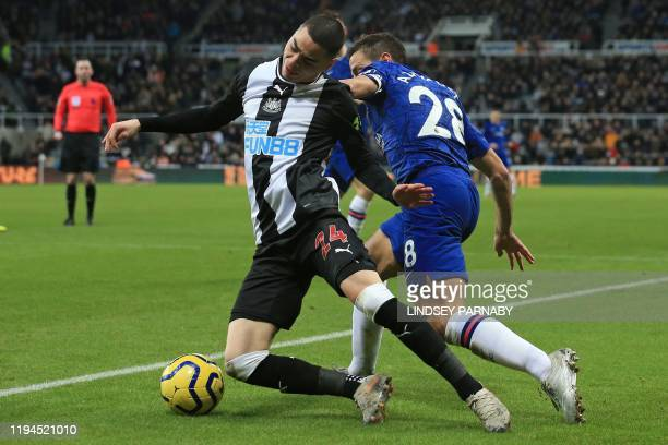Newcastle United's Paraguayan midfielder Miguel Almiron vies with Chelsea's Spanish defender Cesar Azpilicueta during the English Premier League...