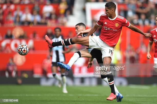 Newcastle United's Paraguayan midfielder Miguel Almiron vies with Manchester United's French defender Raphael Varane during the English Premier...