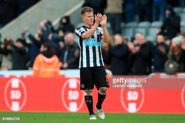 Newcastle United's Scottish midfielder Matt Ritchie applauds at the end of the English Premier League football match between Newcastle United and...