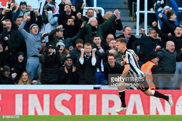 Newcastle United's Scottish midfielder Matt Ritchie celebrates after scoring the opening goal during the English Premier League football match...