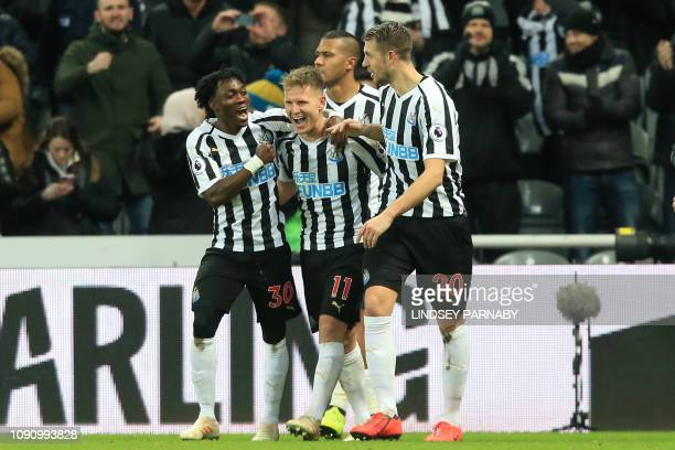Newcastle United's Scottish midfielder Matt Ritchie celebrates with teammates after scoring their second goal from the penalty spot during the...