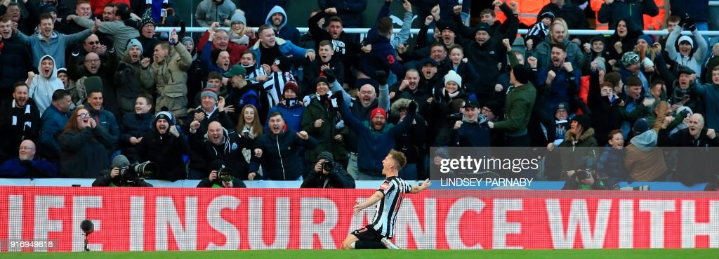 Newcastle United's Scottish midfielder Matt Ritchie celebrates with the crowd after scoring the opening goal during the English Premier League football match between Newcastle United and Manchester United at St James' Park in Newcastle-upon-Tyne, north east England on February 11, 2018. / AFP PHOTO / Lindsey PARNABY / RESTRICTED TO EDITORIAL USE. No use with unauthorized audio, video, data, fixture lists, club/league logos or 'live' services. Online in-match use limited to 75 images, no video emulation. No use in betting, games or single club/league/player publications. /